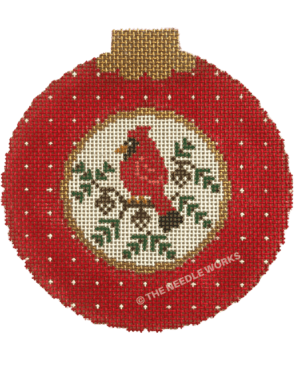 round ornament in red with white circle in the middle with red cardinal on a branch