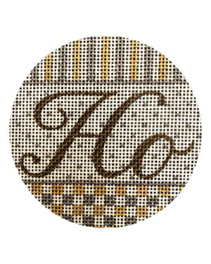 round ornament with HO on silver and gold patterned background