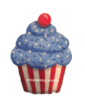 patriotic cupcake with blue frosting and white sprinkles with red cherry on top