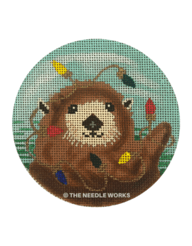 round ornament with sea otter decorated in Christmas lights