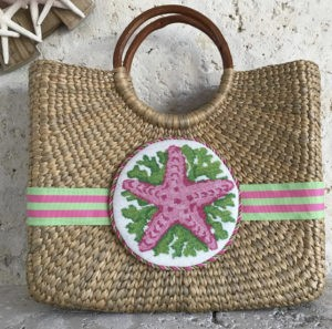 pink seashell canvas on wicker purse