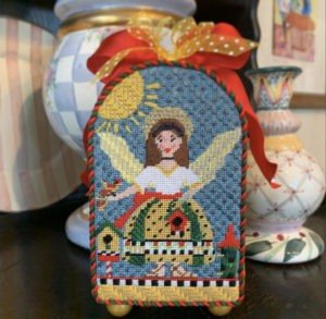 brunette angel with red birds and birdhouse in 3D box shape