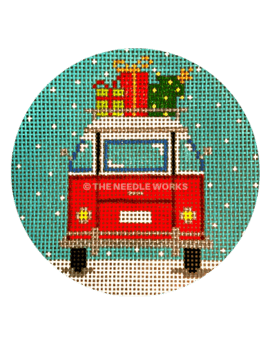 round ornament with red bus in snow with gifts on top of roof