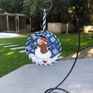 Susan Cluck ornament finishing on metal stand