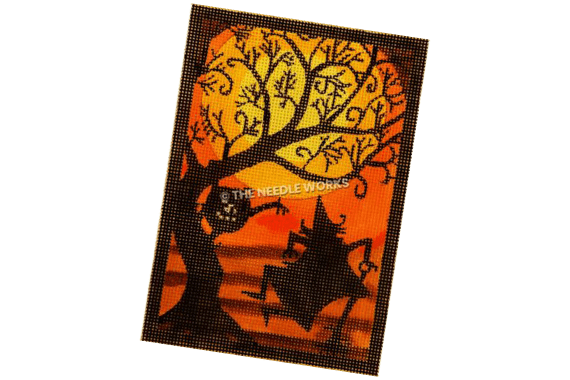 dancing witch by tree with jackolantern with harvest moon background