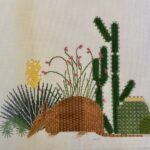 armadillo with southwestern plants canvas